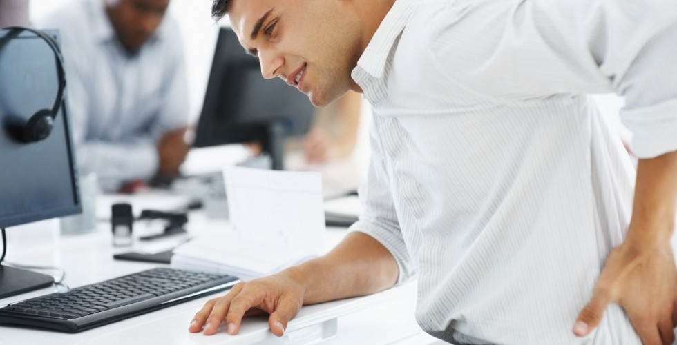 man-at-office-with-low-back-pain